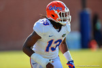 Florida Gators linebacker Daniel McMillian with his arm in a cast runs through drills during football spring practice.  Florida Gators Football Spring Practice.  March 25th, 2016. Gator Country photo by David Bowie.