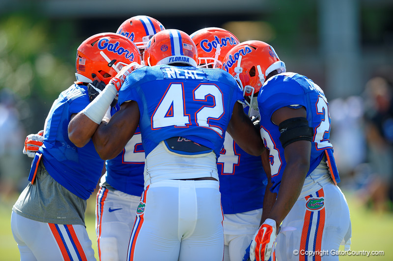 Florida Gators defensive back Keanu Neal and the Gators defense gather together.  Florida Gators Football Sixth Spring Practice.  March 25th, 2016. Gator Country photo by David Bowie.
