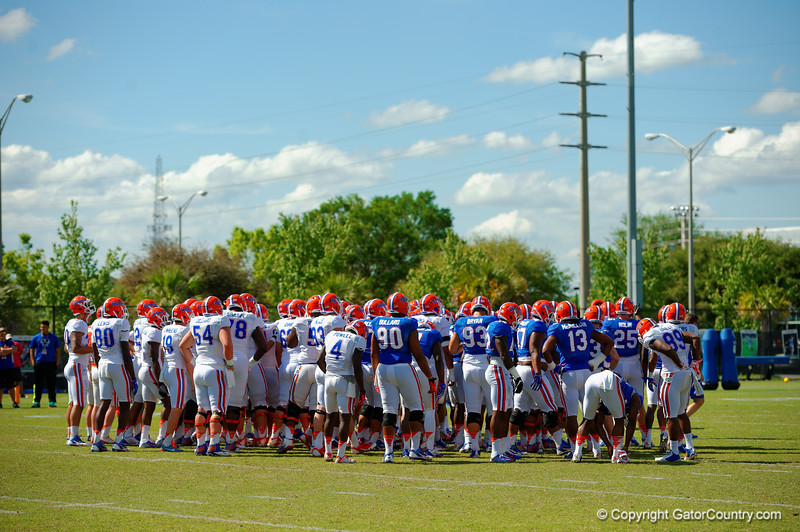 The Gators gather at midfield before breaking out into position drills.  Florida Gators Football Sixth Spring Practice.  March 25th, 2016. Gator Country photo by David Bowie.
