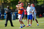 Florida Gators offensive coordinator and quarterbacks coach Doug Nussmeier watches on as Florida Gators quarterback Will Grier throws downfield.  Florida Gators Football Sixth Spring Practice.  March 25th, 2016. Gator Country photo by David Bowie.