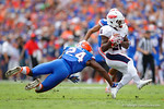 Florida Gators defensive back Brian Poole dives to try and tackle FAU running back Marcus Clark during the first half as the Florida Gators take on the Florida Atlantic University Owls.  November 21st, 2015. Gator Country photo by David Bowie.