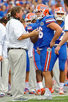Florida Gators head coach Jim McElwain talks with Florida Gators kicker Austin Hardin during the second half as the Florida Gators take on the Florida Atlantic University Owls.  November 21st, 2015. Gator Country photo by David Bowie.