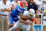 Florida Gators defensive back Jalen Tabor tackles FAU wide receiver Jenson Stoshak during the first half as the Florida Gators take on the Florida Atlantic University Owls.  November 21st, 2015. Gator Country photo by David Bowie.