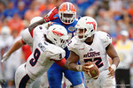 FAU quarterback Jaquez Johnson rolls out of the pocket during the second half as the Florida Gators take on the Florida Atlantic University Owls.  November 21st, 2015. Gator Country photo by David Bowie.