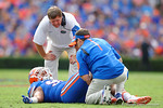 Florida Gators head coach Jim McElwain comes out to check on Florida Gators defensive lineman Jonathan Bullard during the first half as the Florida Gators take on the Florida Atlantic University Owls.  November 21st, 2015. Gator Country photo by David Bowie.