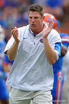 Florida Gators offensive coordinator and quarterbacks coach Doug Nussmeier coaches up the Gators during pregame drills as the Florida Gators take on the Florida Atlantic University Owls.  November 21st, 2015. Gator Country photo by David Bowie.