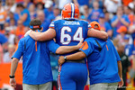 Florida Gators offensive lineman Tyler Jordan is helped off the field during the second half as the Florida Gators take on the Florida Atlantic University Owls.  November 21st, 2015. Gator Country photo by David Bowie.