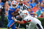 Florida Gators quarterback Treon Harris is sacked by FAU defensive end Trey Hendrickson during the second half as the Florida Gators take on the Florida Atlantic University Owls.  November 21st, 2015. Gator Country photo by David Bowie.