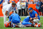 Florida Gators head coach Jim McElwain comes out to check on Florida Gators offensive lineman Tyler Jordan during the second half as the Florida Gators take on the Florida Atlantic University Owls.  November 21st, 2015. Gator Country photo by David Bowie.