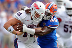 Florida Gators linebacker Jarrad Davis sacks FAU quarterback Jason Driskel during the first half as the Florida Gators take on the Florida Atlantic University Owls.  November 21st, 2015. Gator Country photo by David Bowie.