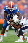 Florida Gators linebacker Jarrad Davis clubs FAU quarterback Jaquez Johnson during the second half as the Florida Gators take on the Florida Atlantic University Owls.  November 21st, 2015. Gator Country photo by David Bowie.