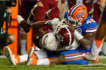 Florida Gators linebacker Jarrad Davis rips the ball away from New Mexico State running back Larry Rose III during the Gators 61-13 win over New Mexico State to start the 2015 season.  September 5th, 2015.  Gator Country Photo by David Bowie.