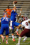 Florida Gators quarterback Will Grier leaps into the air to make a throw during the Gators 61-13 win over New Mexico State to start the 2015 season.  September 5th, 2015.  Gator Country Photo by David Bowie.