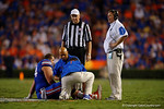 Florida Gators head coach Jim McElwain comes out on the field to check on Florida Gators offensive lineman Cameron Dillard during the Gators 61-13 win over New Mexico State to start the 2015 season.  September 5th, 2015.  Gator Country Photo by David Bowie.