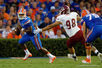 Florida Gators quarterback Treon Harris rolls out during the 61-13 win over New Mexico State.  September 5th, 2015.  Gator Country Photo by David Bowie.
