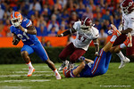 After a clock by Florida Gators tight end Jake McGee, Florida Gators running back Kelvin Taylor is free and sprinting downfield during the Gators 61-13 win over New Mexico State to start the 2015 season.  September 5th, 2015.  Gator Country Photo by David Bowie.