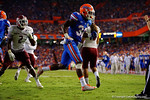 Florida Gators running back Jordan Cronkrite runs through the endzone and off the field following his touchdown during the Gators 61-13 win over New Mexico State to start the 2015 season.  September 5th, 2015.  Gator Country Photo by David Bowie.