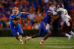 Florida Gators wide receiver C.J. Worton gets the reception and sprints downfield running over an Aggies defender during the Gators 61-13 win over New Mexico State to start the 2015 season.  September 5th, 2015.  Gator Country Photo by David Bowie.