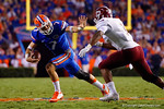 Florida Gators quarterback Will Grier throws out a stiff arm on a quarterback keeper during the 61-13 win over New Mexico State.  September 5th, 2015.  Gator Country Photo by David Bowie.