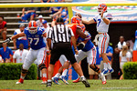Florida Gators quarterback Will Grier leaps into the air for a bad snap during the 2015 Orange and Blue Debut.  April 11th 2015. Gator Country photo by David Bowie.