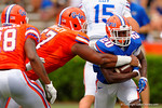 Florida Gators running back Darius Masline rushes up the middle as Florida Gators defensive lineman Caleb Brantley tries to strip the ball during the 2015 Orange and Blue Debut.  April 11th 2015. Gator Country photo by David Bowie.