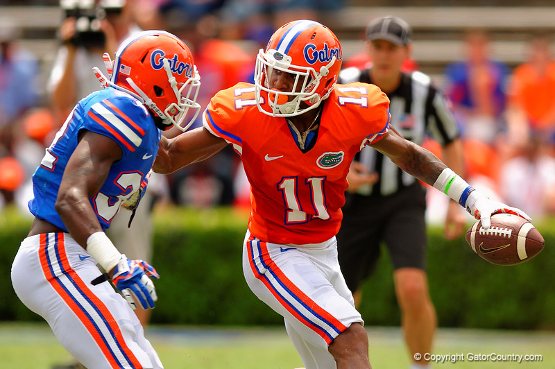 Florida Gators wide receiver Demarcus Robinson uses his stiff arm to try to elude the Blue Gator defender during the 2015 Orange and Blue Debut.  April 11th 2015. Gator Country photo by David Bowie.