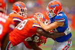 Florida Gators wide receiver C.J. Worton is tackled after making a catch by Florida Gators linebacker Jeremi Powell and Florida Gators safety Duke Dawson during the 2015 Orange and Blue Debut.  April 11th 2015. Gator Country photo by David Bowie.