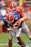 Florida Gators linebacker Matt Rolin attempts to strip the ball from Florida Gators wide receiver Kalif Jackson during the 2015 Orange and Blue Debut.  April 11th 2015. Gator Country photo by David Bowie.