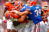 Florida Gators running back Kelvin Taylor is tackled by Florida Gators linebacker Matt Rolin and Florida Gators defensive back Michael Iorio during the 2015 Orange and Blue Debut.  April 11th 2015. Gator Country photo by David Bowie.