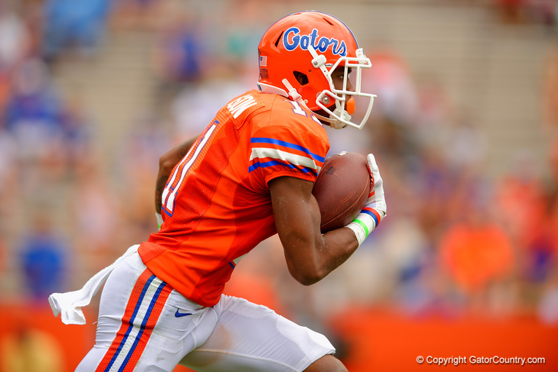 Florida Gators wide receiver Demarcus Robinson sprints upfield after receiving a kick off during the 2015 Orange and Blue Debut.  April 11th 2015. Gator Country photo by David Bowie.