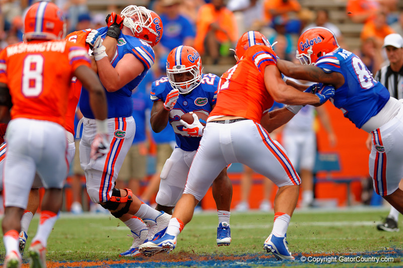 Florida Gators running back Adam Lane Jr. looks for a gap to rush through during the 2015 Orange and Blue Debut.  April 11th 2015. Gator Country photo by David Bowie.