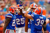 Florida Gators defensive lineman Justus Reed is congratulated by the defense after his huge hit during the 2015 Orange and Blue Debut.  April 11th 2015. Gator Country photo by David Bowie.