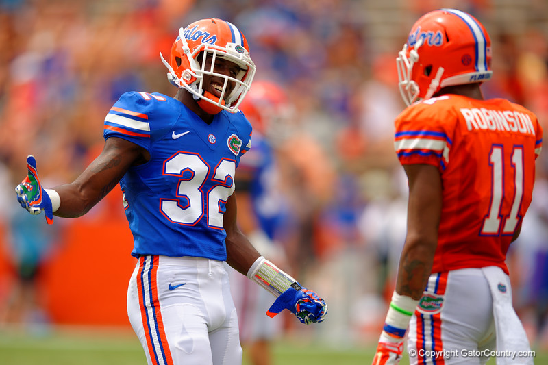 Florida Gators wide receiver D.L. Powell joking around with Florida Gators wide receiver Demarcus Robinson during the 2015 Orange and Blue Debut.  April 11th 2015. Gator Country photo by David Bowie.