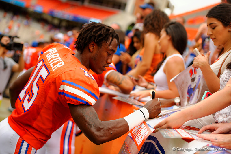 Florida Gators defensive back Deiondre Porter signs autographs during the 2015 Orange and Blue Debut.  April 11th 2015. Gator Country photo by David Bowie.