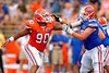 Florida Gators defensive lineman Jonathan Bullard mauls Florida Gators offensive lineman Zach Shinn during the 2015 Orange and Blue Debut.  April 11th 2015. Gator Country photo by David Bowie.