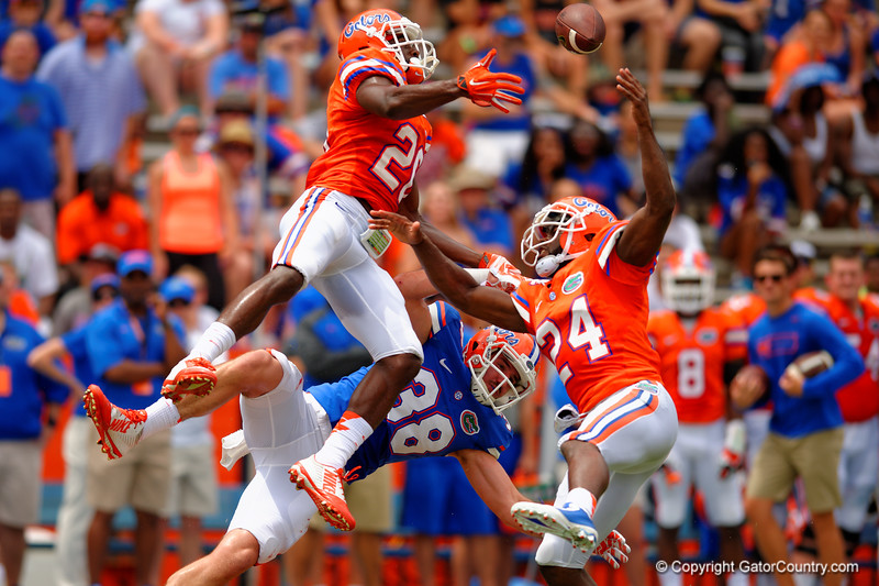 Florida Gators defensive back Marcus Maye and Florida Gators defensive back Brian Poole leap into the air to break up the pass to Florida Gators tight end Bair Diamond during the 2015 Orange and Blue Debut.  April 11th 2015. Gator Country photo by David Bowie.
