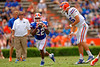 Florida Gators running back Adam Lane Jr. grabs the snap after it bounced off Florida Gators quarterback Jacob Guy during the 2015 Orange and Blue Debut.  April 11th 2015. Gator Country photo by David Bowie.