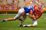 Florida Gators wide receiver Case Harrison makes a catch in the flat and is tackled by Florida Gators linebacker Matt Rolin during the 2015 Orange and Blue Debut.  April 11th 2015. Gator Country photo by David Bowie.