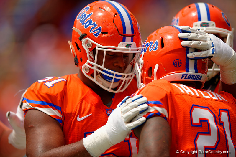 Florida Gators offensive line Antonio Riles congratulates Florida Gators running back Kelvin Taylor after Taylor rushed in for a touchdown during the 2015 Orange and Blue Debut.  April 11th 2015. Gator Country photo by David Bowie.