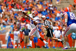 Florida Gators quarterback Treon Harris throws a deep pass while scrambling during the 2015 Orange and Blue Debut.  April 11th 2015. Gator Country photo by David Bowie.