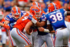 Florida Gators wide receiver Case Harrison is tackled by Florida Gators defensive lineman Justus Reed and Florida Gators linebacker R.J. Raymond during the 2015 Orange and Blue Debut.  April 11th 2015. Gator Country photo by David Bowie.