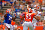 Florida Gators quarterback Jacob Guy throws downfield before Florida Gators defensive lineman Jonathan Bullard gets to him during the 2015 Orange and Blue Debut.  April 11th 2015. Gator Country photo by David Bowie.