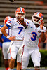 Florida Gators quarterback Treon Harris throwing during warms up as Florida Gators quarterback Will Grier watches on during the 2015 Orange and Blue Debut.  April 11th 2015. Gator Country photo by David Bowie.