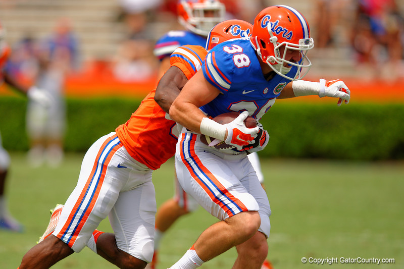 Florida Gators tight end Bair Diamond is tackled after making a catch during the 2015 Orange and Blue Debut.  April 11th 2015. Gator Country photo by David Bowie.