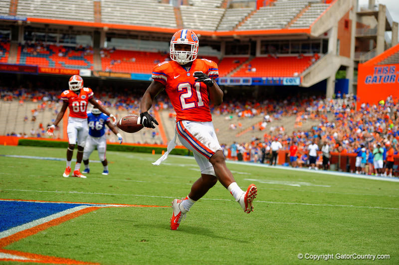 Florida Gators running back Kelvin Taylor finds a huge hole and rushes into the endzone for his second touchdown of the day during the 2015 Orange and Blue Debut.  April 11th 2015. Gator Country photo by David Bowie.