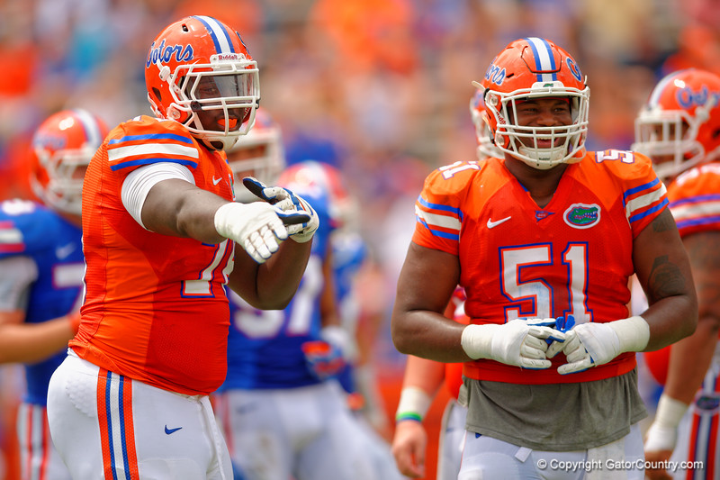 Florida Gators offensive lineman David Sharpe and Florida Gators offensive line Antonio Riles having fun during the 2015 Orange and Blue Debut.  April 11th 2015. Gator Country photo by David Bowie.