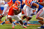 Florida Gators running back Kelvin Taylor jukes during the 2015 Orange and Blue Debut.  April 11th 2015. Gator Country photo by David Bowie.