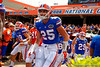 Florida Gators linebacker Matt Rolin runs onto the field during the 2015 Orange and Blue Debut.  April 11th 2015. Gator Country photo by David Bowie.