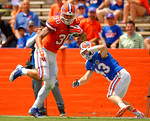 Florida Gators tight end DeAndre Goolsby jukes Florida Gators defensive end Mark Norvelis after making a catch during the 2015 Orange and Blue Debut.  April 11th 2015. Gator Country photo by David Bowie.