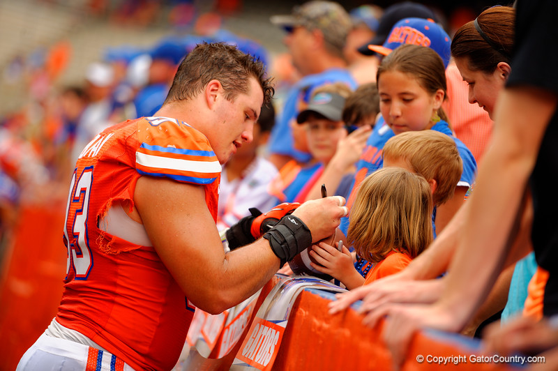 Florida Gators offensive lineman Taven Bryansigns autographs during the 2015 Orange and Blue Debut.  April 11th 2015. Gator Country photo by David Bowie.